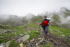Mountain climber woman Stock Photo