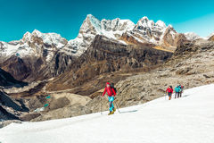 Mountain Climbers ascending Snow Slope on the Way to Summit Stock Photography