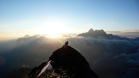 Free Mountain Climbers On A Rocky Ridge At Sunrise Climbing Eiger Mountain In The Swiss Alps Stock Photo - 130452610