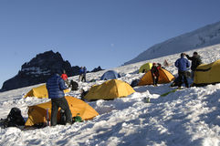 Mountain climbers with tents. On Mt Rainier Stock Image