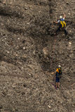Mountain Climbers. Two mountain climbers scaling a steep mountain in Spain Stock Image