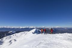 3 mountain climbers walk on snow in mountains. 3 mountain climbers walk on snow in the mountains stock image