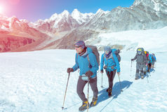 Mountain Climbers walking up on Glacier in weather protective Clothing Royalty Free Stock Photos