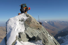 Mountain climbing. Climber climbing dangerous mountain ridge Stock Photography
