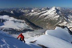 Mountain climbing. Climber ascending snow slope in the Austrian Alps Stock Photos