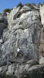 Mountain climbing. Free style mountain climbing on a rough wall in the south of france Royalty Free Stock Images
