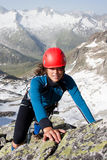 Mountain climbing. Woman climber in summer Austrian Alps Royalty Free Stock Images