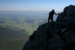 Mountain climbing. Extreme sport - silhouette of a climber stock images