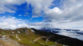 Mountain and cloud. Snowy jiajin mountain in shichuang,China, under cloudy sky Stock Image