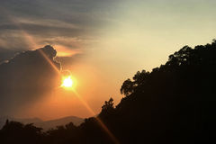 Mountain, cloud, sun and sunlight at sunset Royalty Free Stock Photo