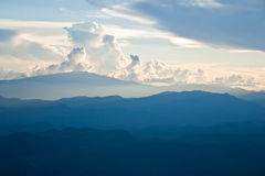 Mountain and cloud. In sunset Stock Image