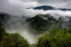 Mountain in the clouds. A beautiful view of a mountain covered in clouds Royalty Free Stock Photography