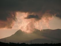Mountain and clouds. Mountain and pink clouds at sunset Stock Photo