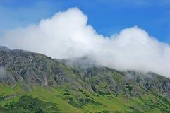 Mountain and Clouds in Alaska Stock Photos
