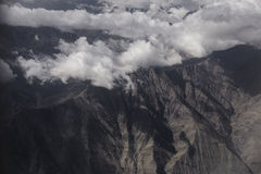 Mountain & clouds in the first time at Leh. Mountain and the clouds capture from airplane Royalty Free Stock Photography