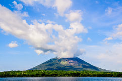 Mountain with Clouds. Mountain in front of water with clouds Stock Images