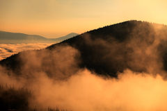 Mountain in clouds and hills in fog Stock Photography