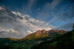 Mountain between clouds stock photos