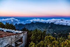 Mountain and clouds with old building Royalty Free Stock Image