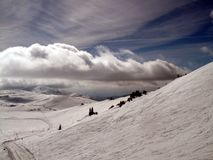 Mountain with clouds and snow. Sunny mountain with beautyfull clouds and white snow royalty free stock photos