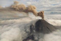 Among the mountain clouds. Volcano karymsky Stock Photo