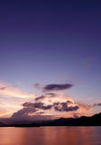 Mountain, cloudscape, dramatic sky and ocean at sunset Royalty Free Stock Images