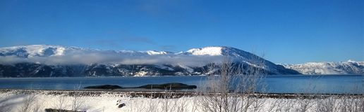 Mountain Coated With Snow Under Blue Sky royalty free stock photography