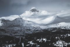 Mountain Coated With Snow Under Gray Sky Stock Image