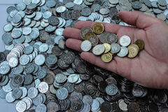 Mountain coins and coins in hand. stock photos