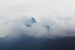 Mountain Corcovado with Christ the Redeemer in clouds and fog in Stock Photo