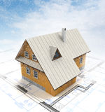 Mountain cottage building with layout plan at winter blizzard Royalty Free Stock Images