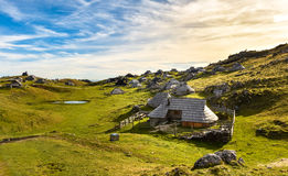 Mountain cottage on idyllic hill Velika Planina Royalty Free Stock Photo
