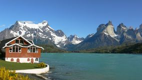 Mountain cottage at lake. A luxurious cottage at lake surrounded by mountains Stock Photos