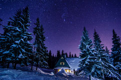 Mountain cottage . Milky Way Galaxy. Purple night sky stars above mountains Royalty Free Stock Photography