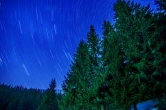 Mountain cottage . Milky Way Galaxy. Purple night sky stars above mountains Royalty Free Stock Photo