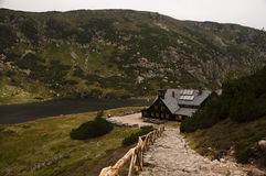 Mountain cottage Samotnia on the Small Pond in the Giant Mount Stock Images