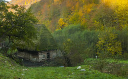 Mountain cottage. Small weathered wooden house in the mountains Stock Image