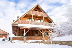 Mountain cottage in winter Royalty Free Stock Images