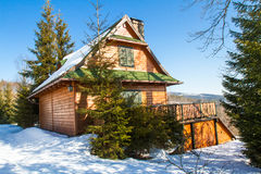Mountain cottage in winter Royalty Free Stock Photo