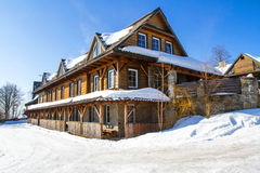 Mountain cottage in winter Royalty Free Stock Photos