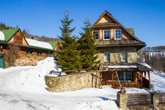 Mountain cottage in winter Royalty Free Stock Photography