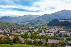 Mountain country village landscape with clouds and blue sky Stock Photos