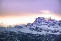 Mountain Cover by Snow Under Orange Sky Stock Photography