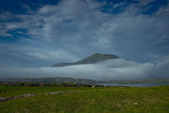 Mountain covered by fog and clouds, Connemara, Ire Stock Image