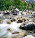The calm of a mountain creek. A mountain creek in the California foothills. a man made wooden structure in the background Royalty Free Stock Photo