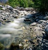 The calm of a mountain creek. A mountain creek in the California foothills. a man made wooden structure in the background Stock Photos