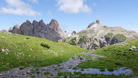 Mountain creek in the Dolomites and clouds. Fast motion stock video footage