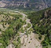 Mountain Creek Empties into River. Small creek leads down into the Shoshone River at the base Rocky Mountains royalty free stock photos
