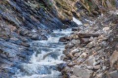 Mountain creek between rocks Royalty Free Stock Photos