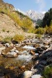 Mountain creek and valley Stock Photos